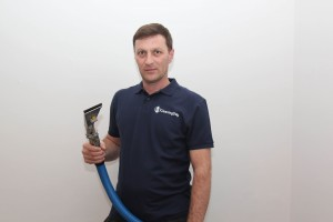 performing deep carpet cleaning service in London
